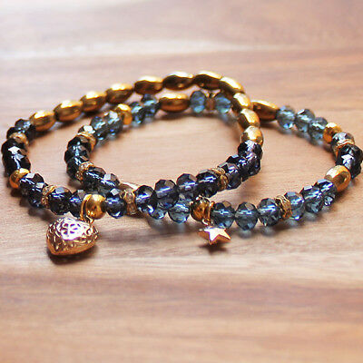 Pair of Delicate Blue Crystal Elastic Bracelets with Gold Heart Charm
