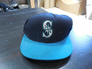 VINTAGE New Era Seattle Mariners Fitted Baseball Hat Cap Size 7 Blue ... 2e0dc3550efe