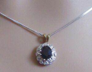 Secondhand-9ct-white-gold-oval-sapphire-multi-diamond-pendant-amp-chain-17-inches