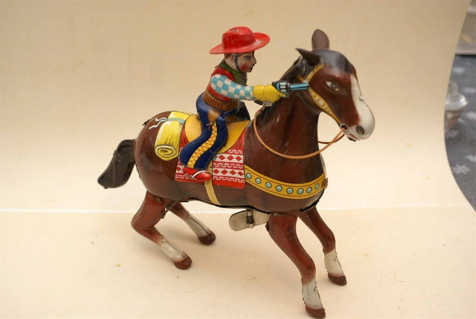 Haji cowboy on horse wind up   mint