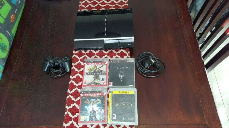 Playstation 3 Phat Consol 60 Gig and playstation games for sale