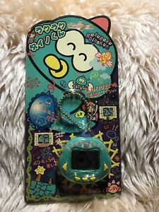 RakuRaku-DinoKun-Dinkie-Dino-Electronic-Virtual-Pet-TK-910-Color-Green-Original