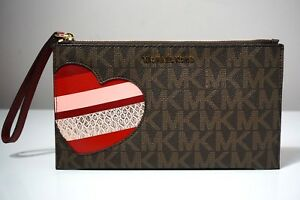 8bff7d5363e35c Michael Kors Jet Set Signature Hearts Brown/Cherry Large Zip Clutch ...