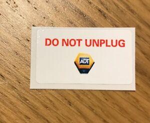 Genuine-ADT-039-DO-NOT-UNPLUG-039-Sticker-Decal-24-Hour-Alarm-Monitoring-4cm-x-2cm