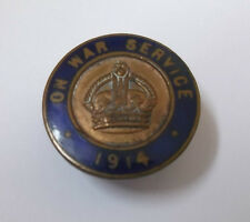 on war service 1914  vintage circular enamel  lapel  badge