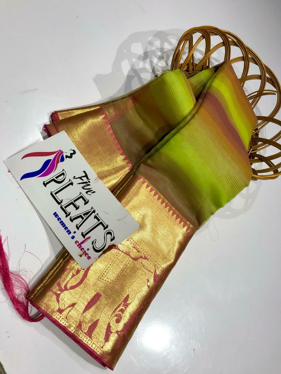 Saree has beautiful printed dual color strips golden border with elephant weavin