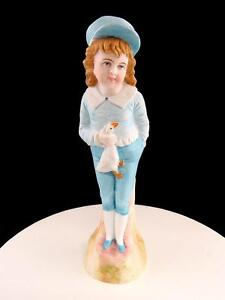 """GEBRUDER HEUBACH GERMANY BOY IN BLUE OUTFIT HOLDING DUCK 9 3/8"""" BISQUE FIGURINE"""