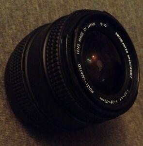 Promaster Spectrum 7 28-70mm Zoom 1: 3.5 4.5 Camera Canon Lens W/ Lens Hood