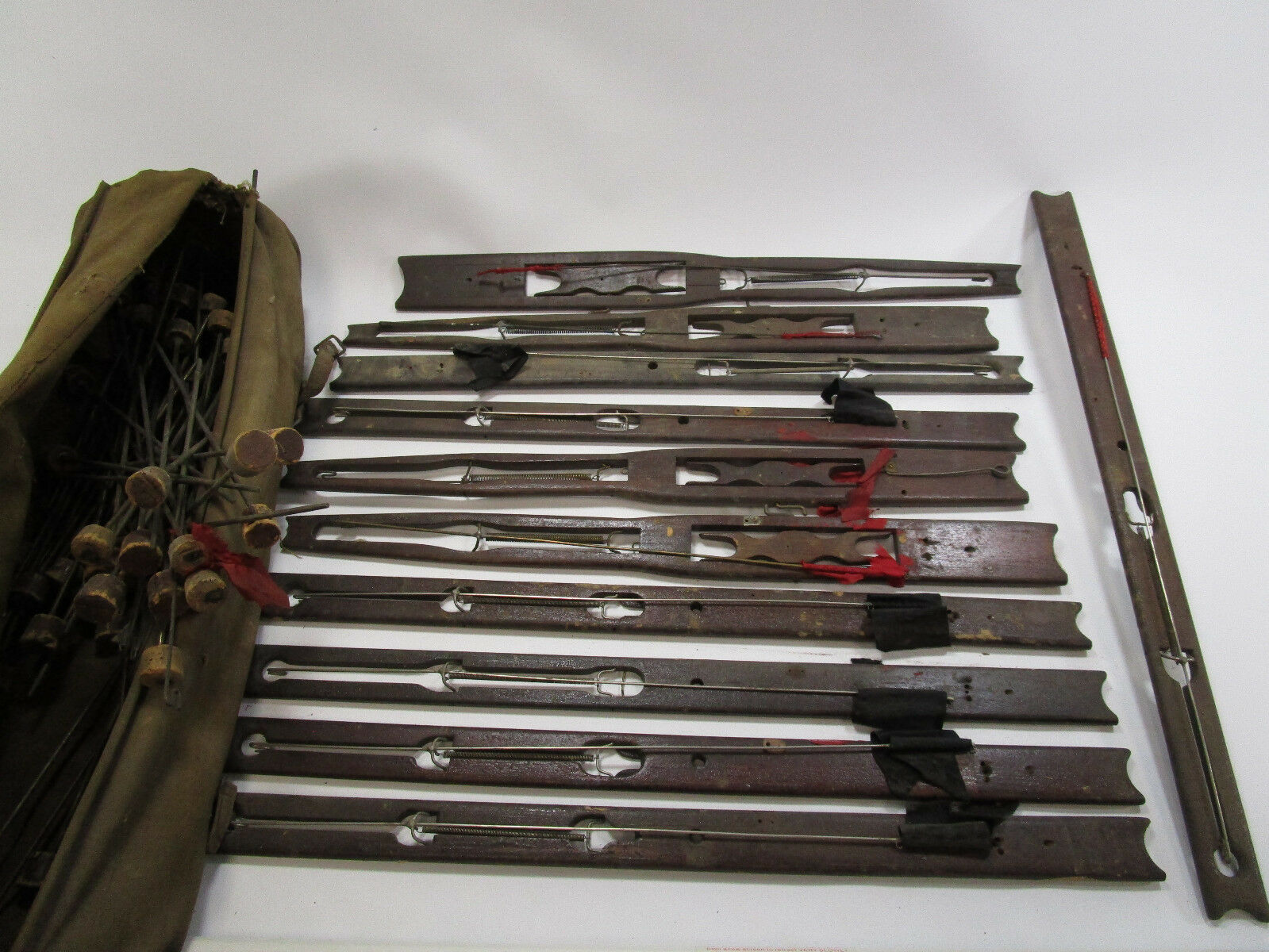 Vintage set of 11 Wooden ice fishing tip ups in Bag with metal cork