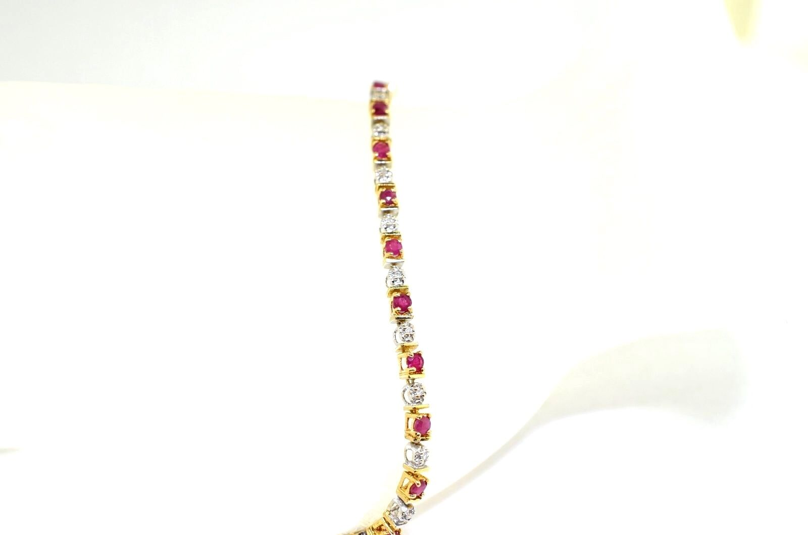14k Two Tone gold, Ruby, And Diamond Bracelet .7.5