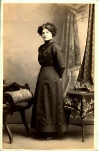 Young lady portrait RPPC postcard antique photograph adorable English by table