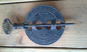 RARE GRISWOLD REVERSIBLE STEEL SPINDLE.......LOOK