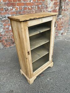 ANTIQUE STRIPPED WOOD GLASS-FRONTED CABINET WITH SHELVES - SMALL MUSIC CABINET