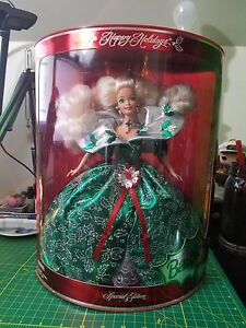 Holiday barbie dolls collectible and pink box.