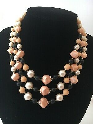 Multi strand pink and peach beaded necklace with hook closure.