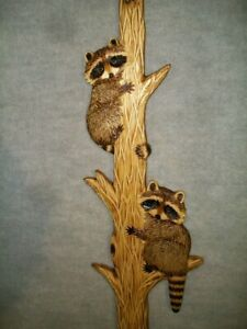 Hand carved 2 raccoon cubs up tree wall art chainsaw wood carving