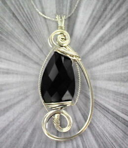 FACETED-BLACK-ONYX-GEMSTONE-PENDANT-IN-STERLING-SILVER-WIRE-WRAPPED
