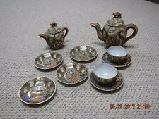 Satsuma Dragonware and Empress Tea Set, includes two pots, six plates, two cups