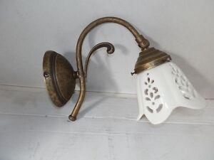 Applique in ottone brunito con ceramica traforata ad luce