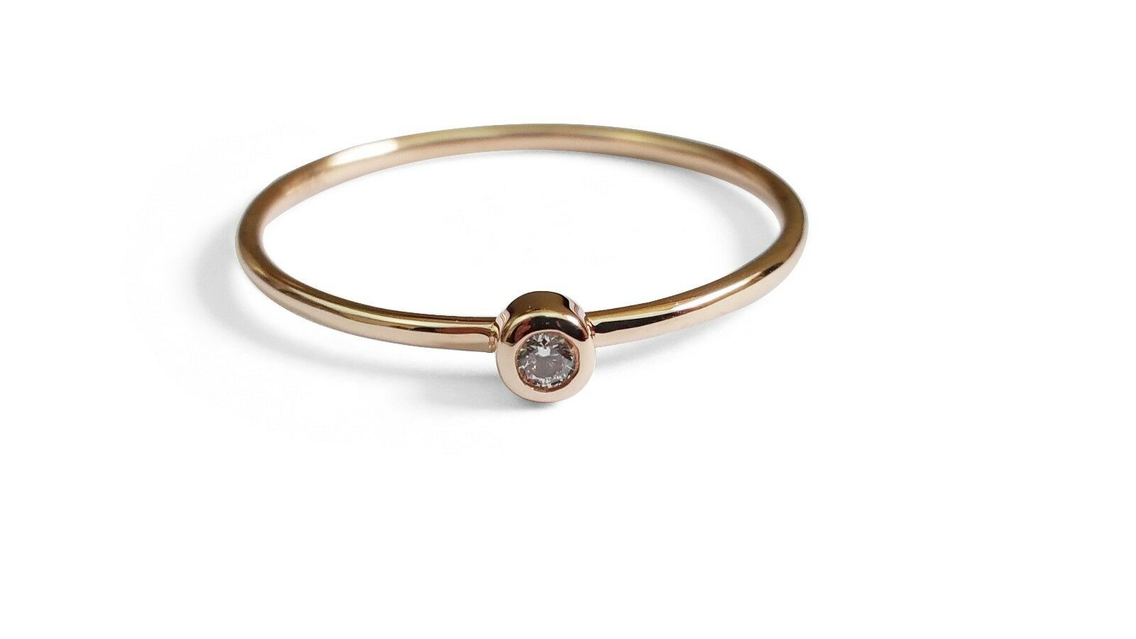 Round Diamond Solid gold Ring. 14K pink gold.