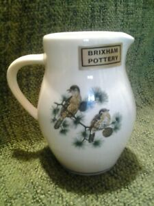 VINTAGE-BRIXHAM-POTTERY-1-2PINT-MILK-JUG-WITH-ORIGINAL-LABEL
