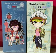 A COLLECTION OF 2 BRAND NEW TANGKOU DOLLS: CHINESE AND GAP YEAR