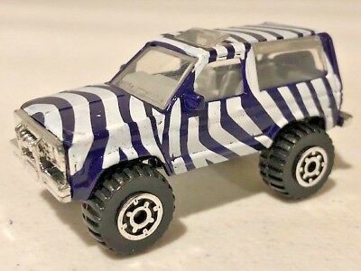 Purple White Safari stripes 1//64 Loose Matchbox Ford Bronco II