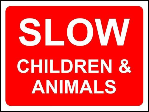 Slow children and animals safety sign