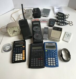 Electronics lot walkie, mini recorders, remotes, calculators, clock, radio AS IS