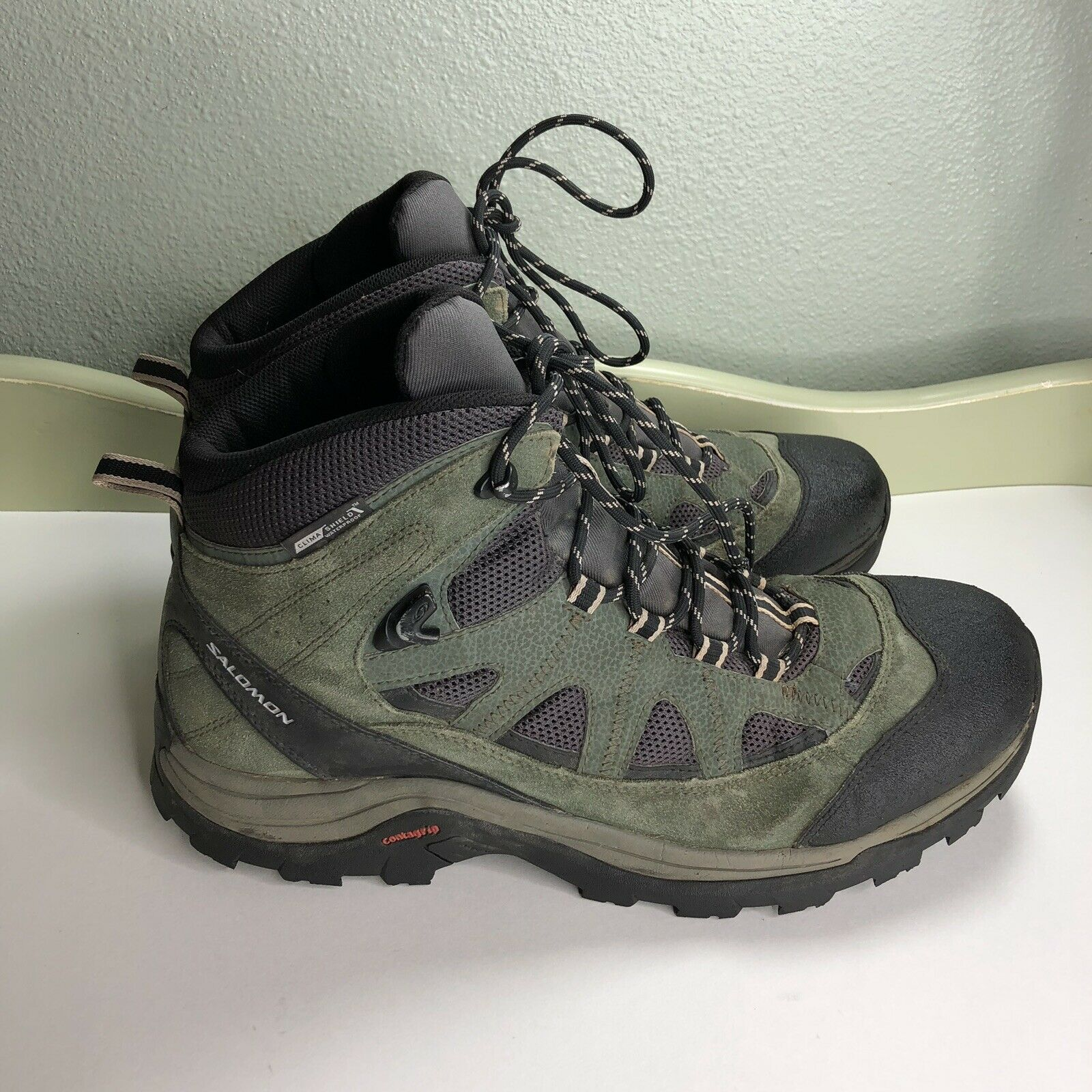 Salomon Hiking Boots Men Size  13.5 Great Condition  here has the latest