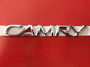 camry emblem rear trunk toyota camry 02 03 04 05 06 oem 75442. Black Bedroom Furniture Sets. Home Design Ideas