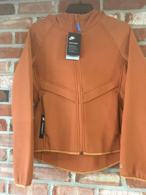 775a2b4c4fe9 NIKE WOMEN S SZ M NSW TECH PACK WINDRUNNER JACKET Pumpkin AQ7827 246 MSRP   150+