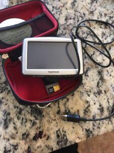 Tom Tom XL N14644 Navigation System With Case Logic It Works Bundle