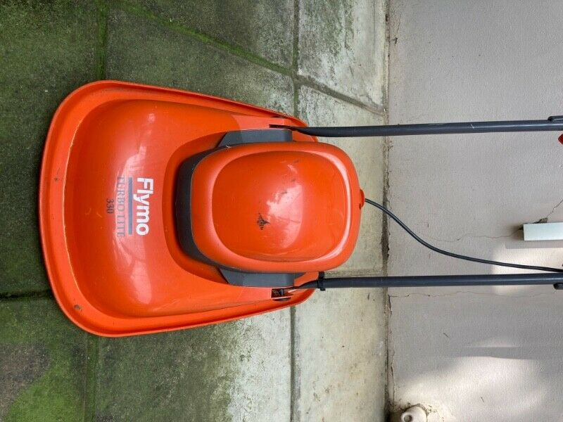 Lawn mower, including long extension cord
