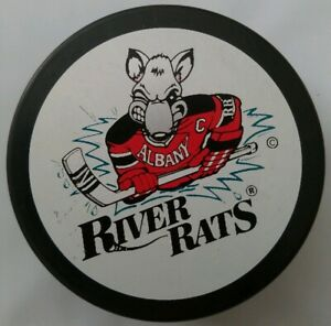 ALBANY-RIVER-RATS-VINTAGE-AHL-OFFICIAL-VEGUM-MFG-HOCKEY-PUCK-MADE-IN-SLOVAKIA