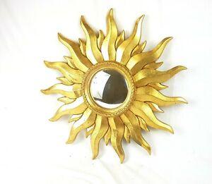 Miroir-soleil-il-de-sorciere-au-cadre-en-resine-dore