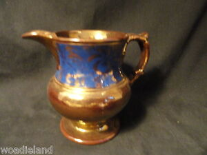 Antique-Copper-Luster-Creamer-or-Pitcher-4-5-in-With-Blue-Floral-Decoration