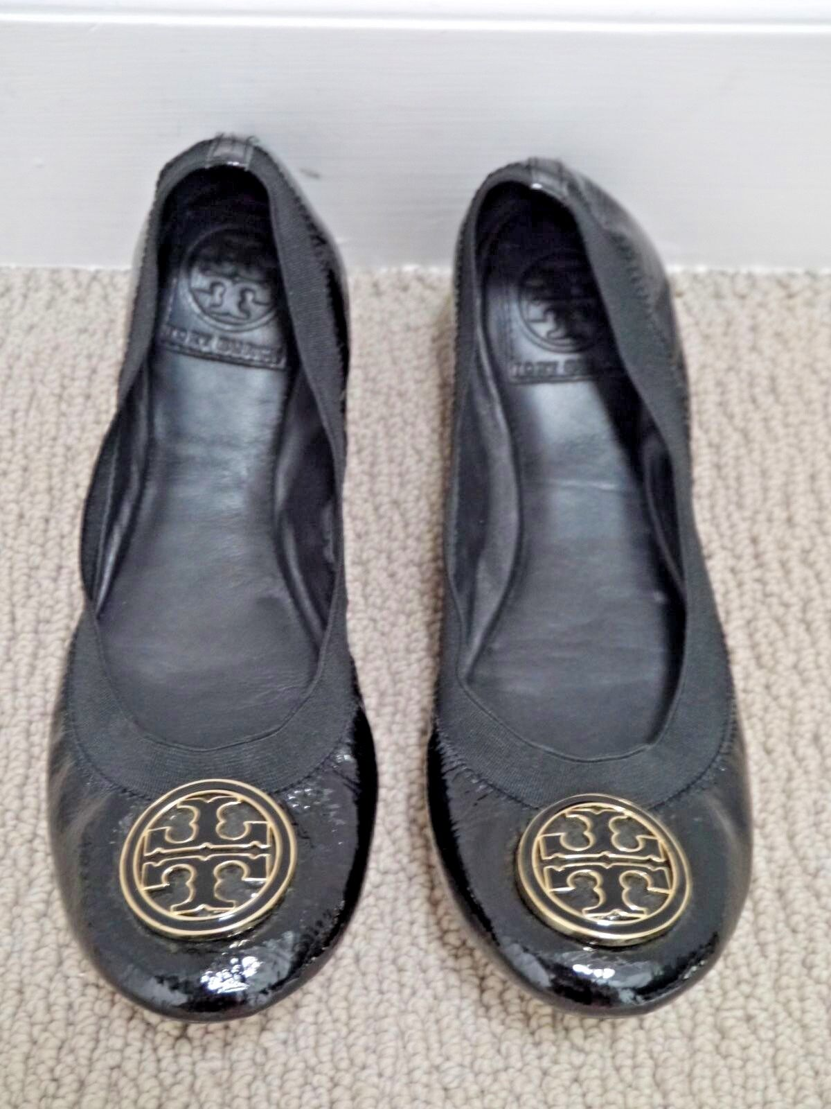 1b53d354c33 TORY BURCH Caroline Caroline black patent leather gold detail logo ...