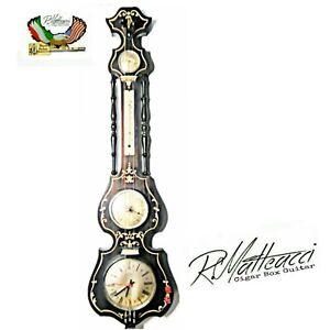 Orologio-vintage-da-parete-Lap-steel-guitar-clock-by-Robert-Matteacci