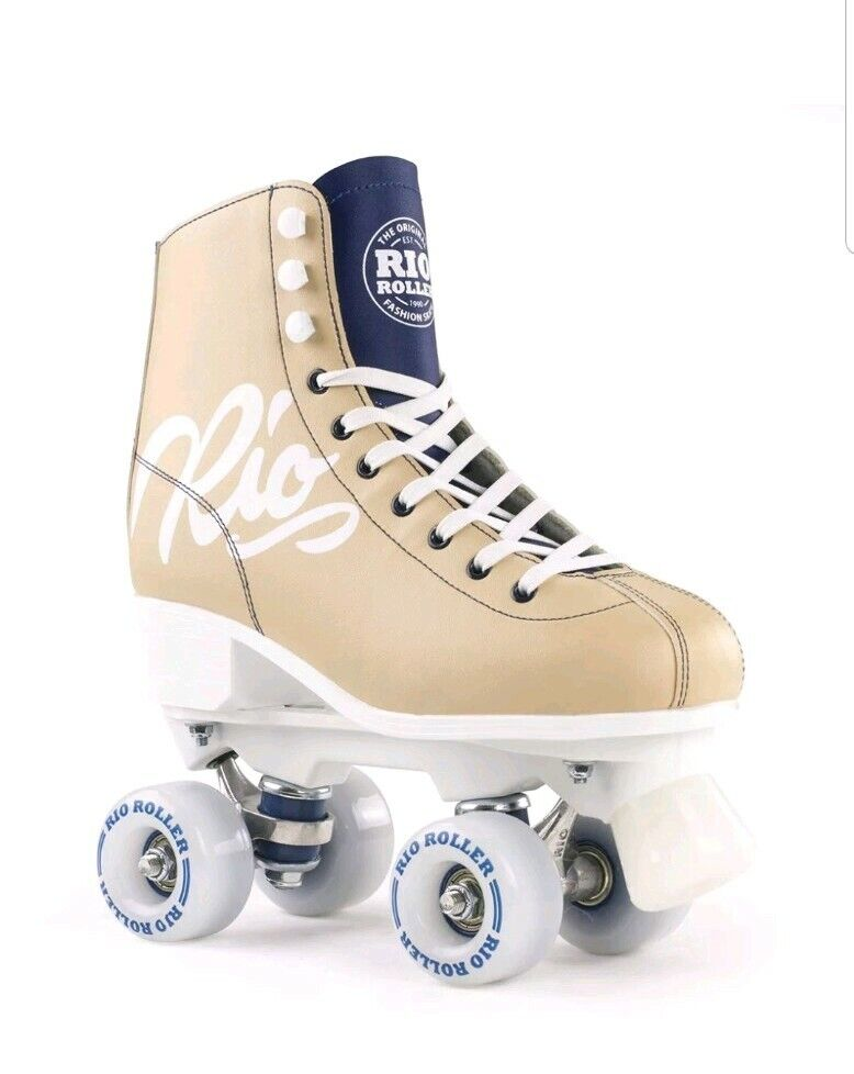 Rio Roller Scripts Tan.  Adult.  Size  7.5 US wemens.  quality first consumers first