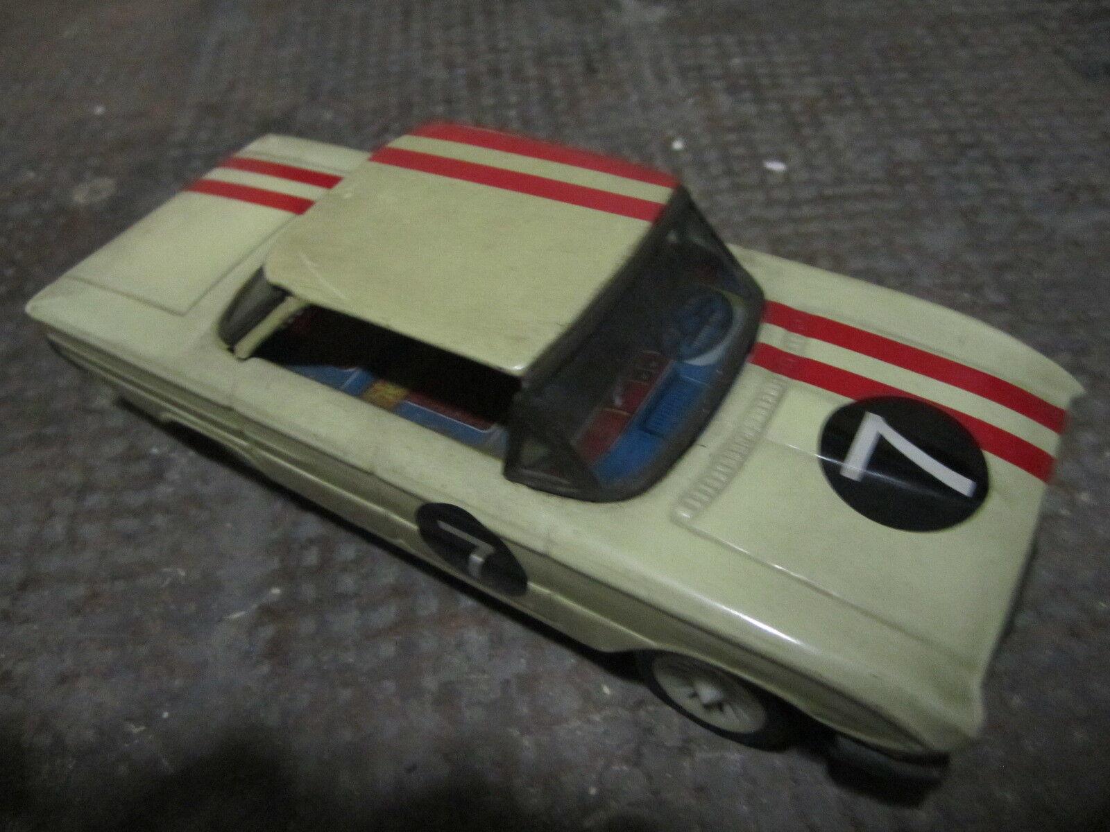 Tin Toy Auto latta a carica anni '60