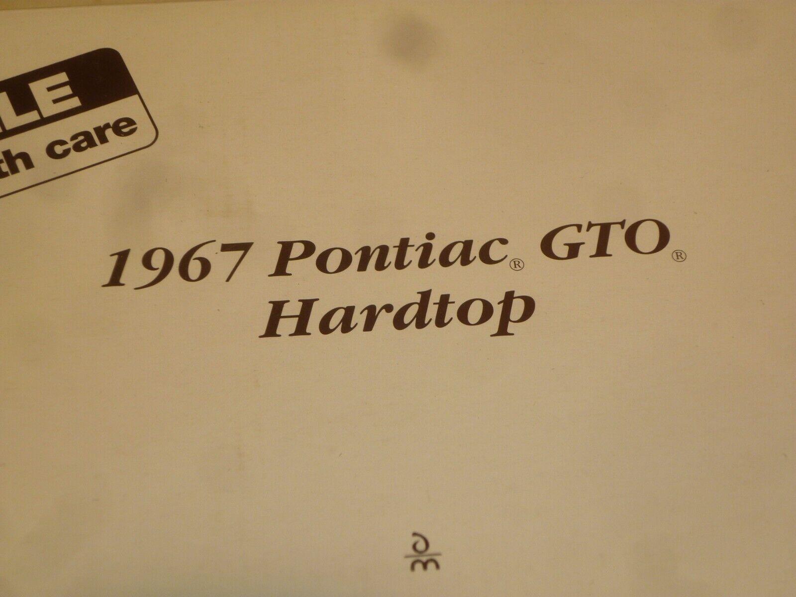 A Danbury mint scale model of a 1967 Pontiac GTO. ( plum )  boxed
