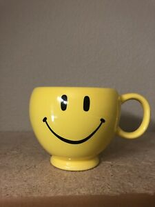 Smiley face in coffee cup