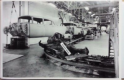 "1957 Chevrolet assembly line Body in the air 12X18"" Black & White Picture"