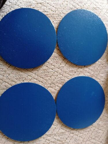 Round simulated leather coasters.