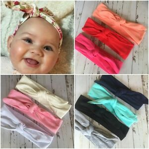 Miss-JANE-Newborn-Baby-Girls-Stretch-Bow-Top-Knot-Headband-Plain-Colours