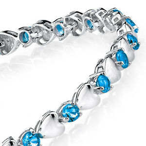 925-Sterling-Silver-Blue-Topaz-Heart-Shaped-Cubic-Zirconia-Puff-Tennis-Bracelet