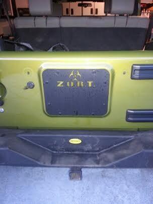 "jk jeep spare tire  "" Z.O.R.T."" cover plate 07'-17'"