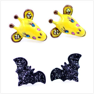 Multiple-animal-themed-earrings-yellow-giraffe-black-bat-batman-stud-earrings
