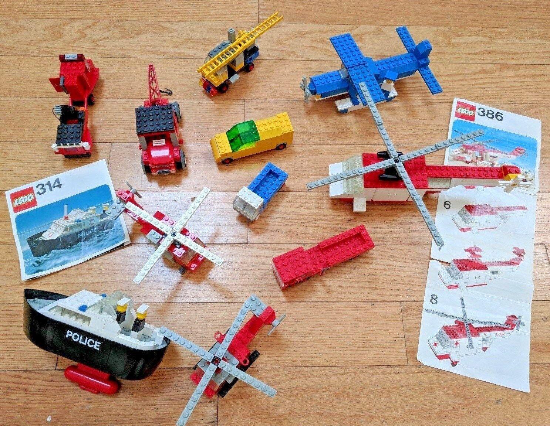 Vintage Lego lot of 11 Figures Plane, Boat, Copter, Manuals, 314 386 709 Etc.